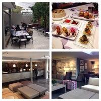 Photo taken at Lola Restaurante & Lounge by David R. on 12/11/2013