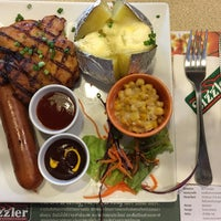 Photo taken at Sizzler by TapShaddy on 5/22/2016
