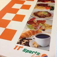 Photo taken at 11• Sports Cafe by Lela R. on 5/4/2014