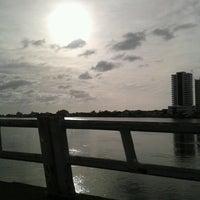 Photo taken at Ponte Giuseppe Garibaldi (Ponte Tramandaí - Imbé) by Marcelo L. on 3/24/2013