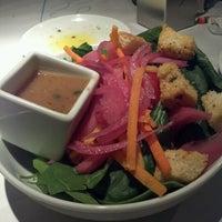 Photo taken at Romano's Macaroni Grill by Miranda O. on 12/24/2011