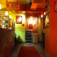 Photo taken at The Couch Tomato Café by Carlos S. on 9/16/2011