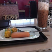 Photo taken at Library Café by Nichada S. on 6/29/2012