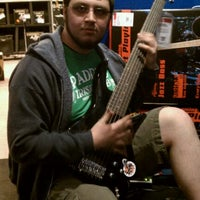Photo taken at Guitar Center by Rob G. on 4/23/2011