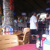 Photo taken at The Hut Bar and Grill by Jim S. on 8/27/2011