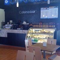 Photo taken at Café Punta Del Cielo by Rosa G. on 3/10/2011