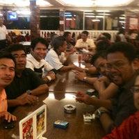 Photo taken at Restoran Lotus (Restaurant) by Muhi C. on 6/30/2012