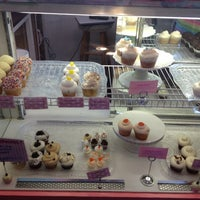 Photo taken at LuLi's Cupcakes by mechelle c. on 4/1/2012