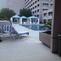 Photo taken at Hilton Rooftop Pool by ESTHER on 6/23/2012