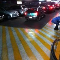 Photo taken at Estacionamiento by Villegas G. on 4/28/2012