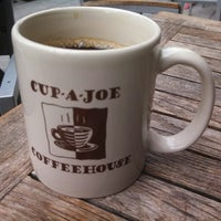 Photo taken at Cup-A-Joe Coffee House by Jeff D. on 5/10/2013