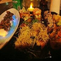 Photo taken at Lotus Japanese Fusion Cuisine by Roberta C. on 3/16/2013