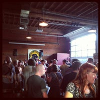 Photo taken at Lucky Labrador Beer Hall by Andrew R. on 6/7/2013