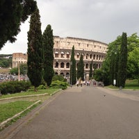 Photo taken at Piazza del Colosseo by Dario B. on 5/18/2013