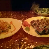 Photo taken at Ocean Blue Sushi by Laramie T. on 3/16/2013