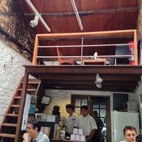 Photo taken at Kala Ghoda Café by SS on 6/23/2013