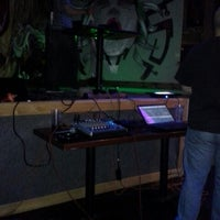 Photo taken at The Lion's Den Pub and Grill by Travis M. on 6/7/2013