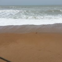 Photo taken at Sandspit by Mustafa A. on 7/29/2014
