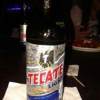 Photo taken at Arena Restaurante & Bar by Rocío E. on 7/31/2014