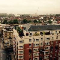 Photo taken at Copthorne Tara Hotel by Mark T. on 10/13/2014