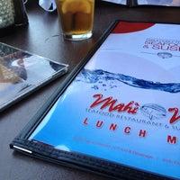 Photo taken at Mahi Mah's Seafood Restaurant by Tina L. on 4/17/2013