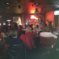 Photo taken at Theo's Grill & Bar by Larry M. on 12/29/2013