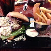 Photo taken at Red Robin Gourmet Burgers by Andrea L. on 5/15/2014