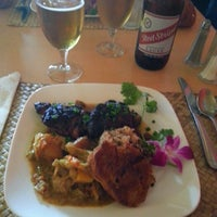 Photo taken at Jawaiian Irie Jerk Restaurant by Ricky S. on 4/10/2013