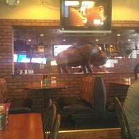 Photo taken at Native Grill & Wings - Ray Road by Marnie K. on 4/11/2013
