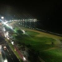 Photo taken at Praia da Costa by Carolini S. on 4/9/2013