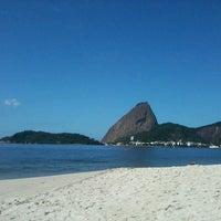 Photo taken at Praia do Flamengo by Paula R. on 4/23/2013