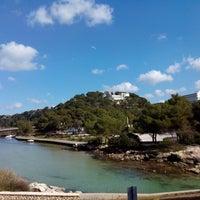 Photo taken at Cala Galdana by Doly S. on 3/9/2014
