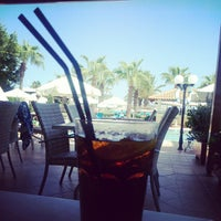 Photo taken at Okeanos Beach Hotel by Марина А. on 8/26/2013