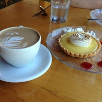 Photo taken at Wild Wheat Bakery Cafe & Restaurant by Linda C. on 6/24/2013