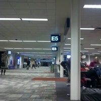 Photo taken at Gate E5 by Leia R. on 1/1/2013
