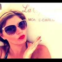 Photo taken at La Spiaggia Beach by Violetta on 8/7/2014