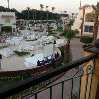 Photo taken at Cataract Pyramids Resort Giza by Ehab K. on 6/26/2014