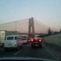 Photo taken at Ponte das Bandeiras by Letícia S. on 8/12/2013