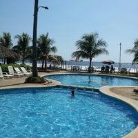 Photo taken at Punta Roca by Mario G. on 12/8/2012