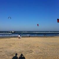 Photo taken at Praia de Imbé by Vinicius T. on 4/27/2013