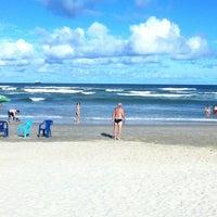 Photo taken at Praia de Imbé by Vinicius T. on 2/16/2013