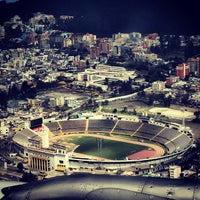Photo taken at Estadio Olimpico Atahualpa by Camilo S. on 11/13/2012