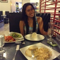 Photo taken at Mexitalian Cuisine by Angela Ena on 6/14/2013