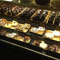Photo taken at Truffles & Tortes Dessert Cafe by Katie P. on 7/6/2013