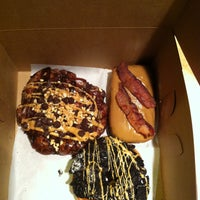 Photo taken at Voodoo Doughnut by Jason T. on 5/10/2013