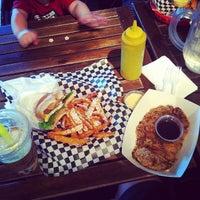 Photo taken at Bun Bun Gourmet Burger and Tea House by Joe C. on 9/29/2013