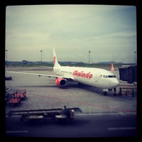 Photo taken at Gate A6 by Andrian T. on 4/11/2013