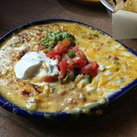 Photo taken at On The Border Mexican Grill & Cantina by Christopher C. on 5/4/2015
