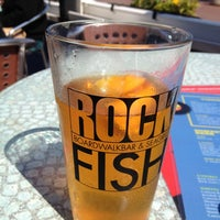 Photo taken at RockFish Boardwalk Bar & Seagrill by Stephanie P. on 5/28/2013