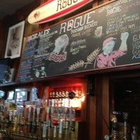 Photo taken at Rogue Ales Public House & Distillery by Tom C. on 6/23/2013